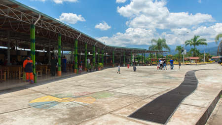 Archidona, Napo / Ecuador - October 10 2020: People walking outside the typical food court in the center of the town of Archidona in the Ecuadorian Amazon