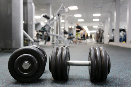 gyms: Dumbbells on floor in gym Stock Photo