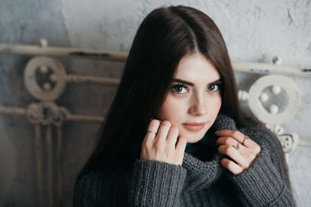 Clouse up portrait of a girl in a gray sweater