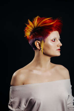 Punk girl with colour dyed hair looking right 스톡 콘텐츠