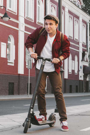 Guy having fun on scooter, Moscow, Russia