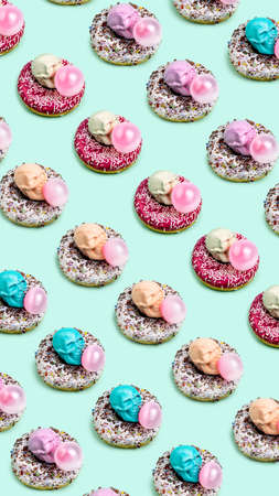 Creative pattern made with donuts and pink skulls. Minimal pop art Halloween concept. Flat Lay.