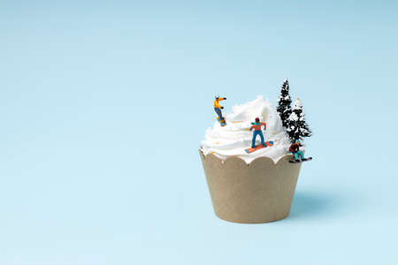 Creative layout made with snowboarders on muffin. Minimal colorful winter sports concept.