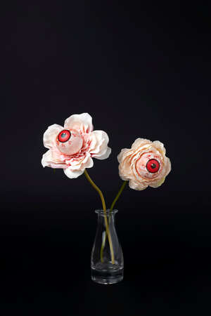 Creative Halloween layout with eyeballs flower in vase. Minimal holiday fun spooky concept. Autumn season background.