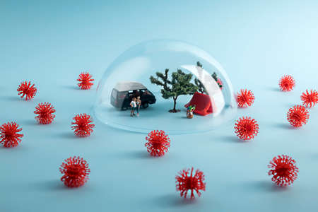 Creative coronavirus layout made with people camping under the glass dome, surrounded by virus. Minimal stay at home wallpaper. Self-isolation and coronavirus pandemic concept.