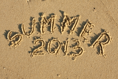 Inscription on wet sand Summer 2013 photo