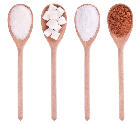 Wooden spoons with sugar, lump sugar, salt, cocoa, isolation on a white background