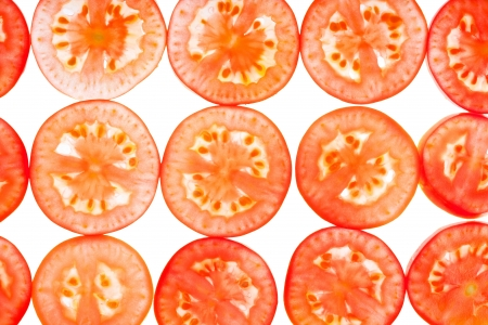 Background  thinly sliced tomato, isolated on white