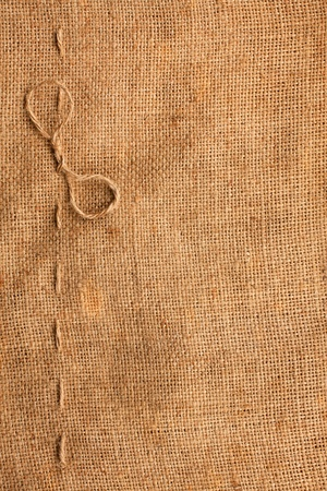 Texture of fabrics of canvas decorated stitching and a bow  as background