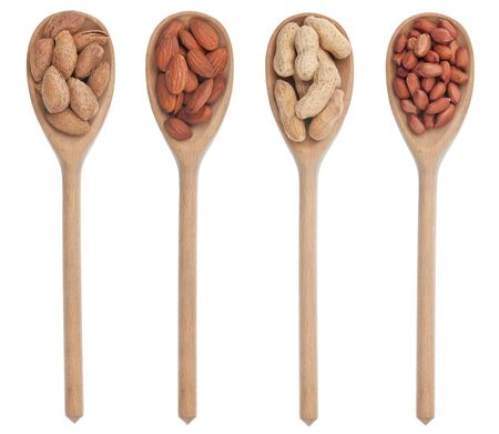 Peeled and unpeeled almonds and peanuts in a wooden spoon, isolated on a white background photo