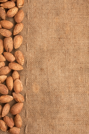 The almonds lying on burlap  can use as background