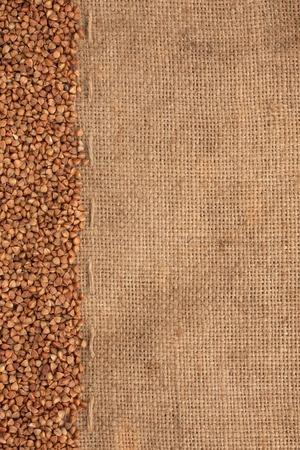 buckwheat lying on sackcloth can use as background photo