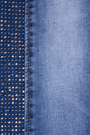 Yellow rhinestones and yellow seam on denim, background, texture