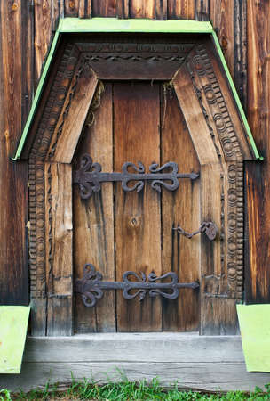 The wooden door of the church of the 19th century Ukraine