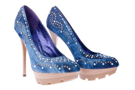 Blue denim shoes, isolated on white  photo