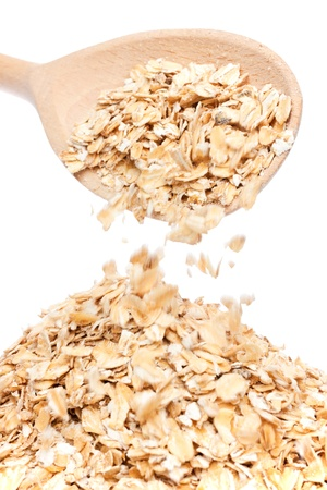 oat-flakes is poured with a wooden spoon Stock Photo - 17112768