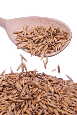oat  is poured with a wooden spoon Stock Photo - 17112762