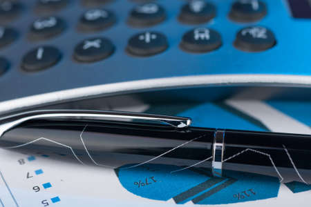 Pen,calculator and dollars  closeup  Business concept  photo
