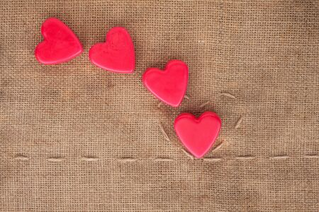 Five of hearts on sackcloth can use as background