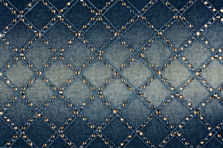 Light-blue denim with yellow and silver rhinestones, background