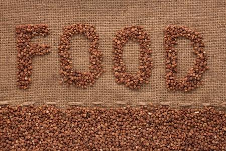 Word to   food  write  buckwheat groats on sacking,background photo