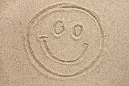 smiley face painted by in the sand, concept, background photo