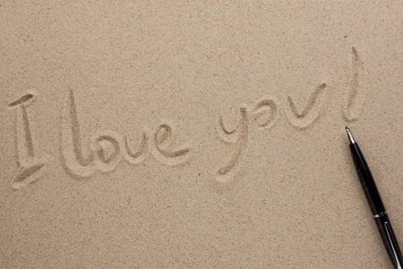 I love you written in pen on the sand, as the background photo