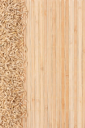 bamboo mat: Oatmeal on a bamboo mat and place for text Stock Photo