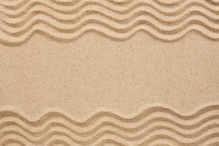 wavy lines in the sand with space for text Stock Photo