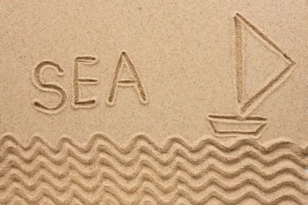 The word  sea  written on the sand, as the background Stock Photo