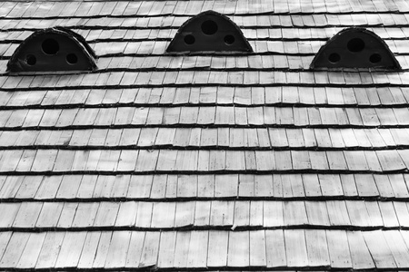 cedar shakes: Fragment of old wooden roof of the house, the texture Stock Photo