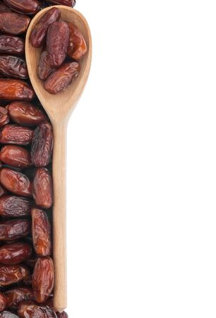 dates fruit: Wooden spoon with dates, isolated on white background