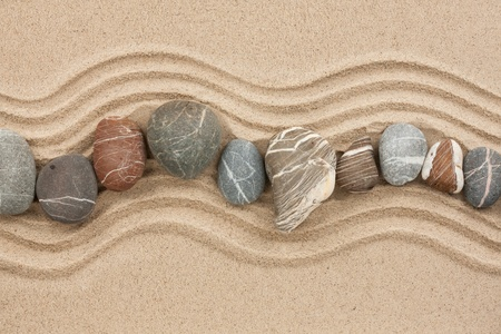 Striped stones on the sand,can be used as background photo