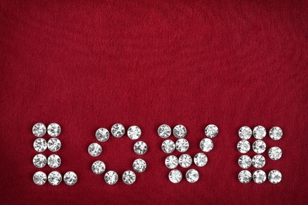 The word  love made by ​​with rhinestones, can be used as background