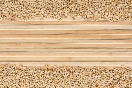 bamboo mat: barley on a bamboo mat and place for text