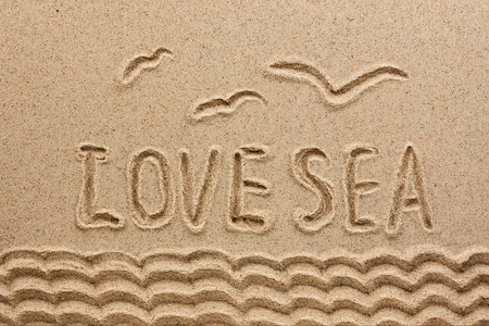 The word  sea  written on the sand, as the background Archivio Fotografico