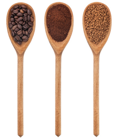 Three spoons freshly ground coffee, beans, granular, isolated on white background photo