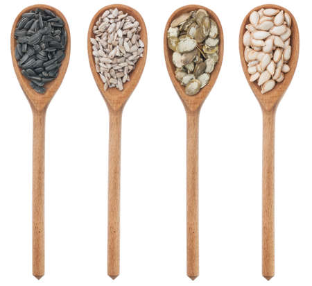 Spoons with sunflower and pumpkin seeds, isolated on a white background photo
