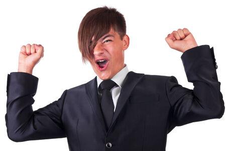 Joyful businessman raised his hands, isolated on white background photo