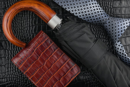 A necktie, wallet, umbrella  lying on the skin, can be used as background