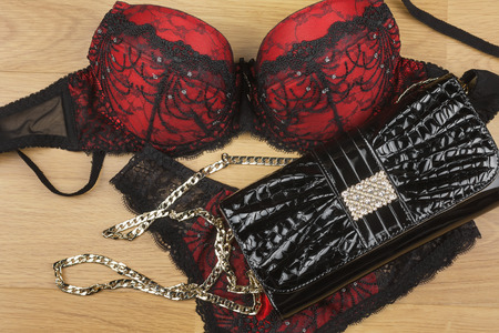 Lingerie  and bag  lying on the laminate can be used as background photo