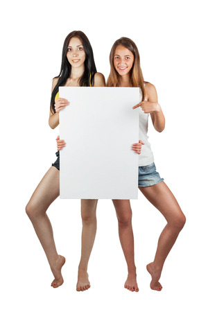 Two girls hold a poster, isolated on white background photo