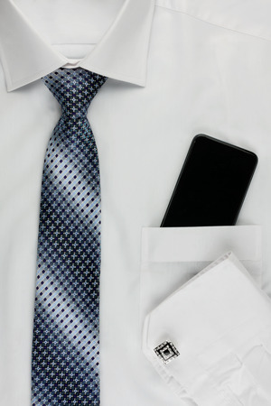 cuff: Shirt, tie, cuff links and a mobile phone, can be used as background  Stock Photo