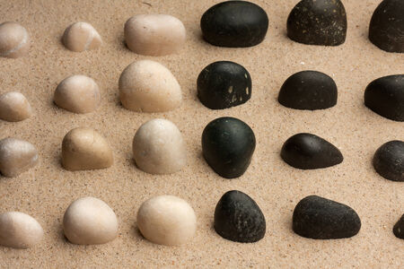 Stones sticking out of the sand, can be used as a background  photo