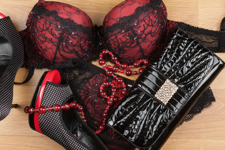 Lingerie,beads, shoes and bag  lying on the laminate can be used as background Zdjęcie Seryjne