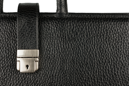 Classic mens briefcase with a lock and handle, close-up photo