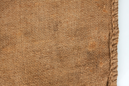 Rough seam on an old burlap, white background