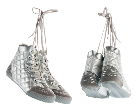 gym shoes: Silvery flying gym shoes with rhinestones hanging by laces