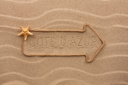 cote d'azur: Arrow made of rope and starfish with the word Cote d-azur