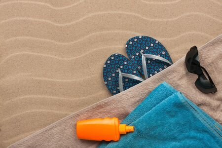 beach feet: Mens accessories for the beach lying on the sand